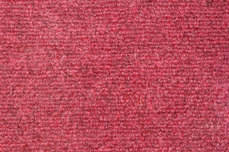 Red plastic doormat texture and background. photo