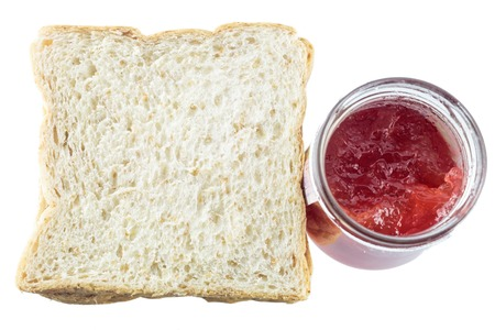 strawberry jam sandwich: Closeup pile of sliced bread with strawberry jam on white background.
