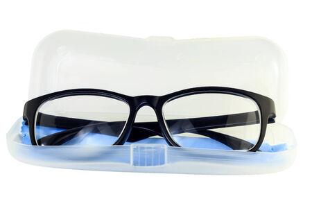 bifocals: Eye glasses, Black eye glasses on cover of case isolated on white background.