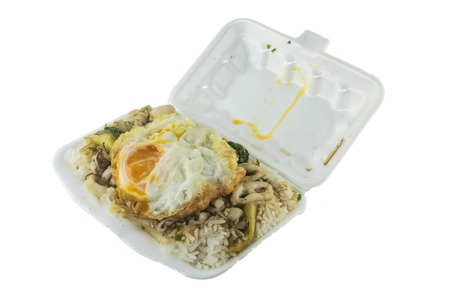 Thai food,rice with fried egg on top.Santed pork with chili & Basil leaves. photo