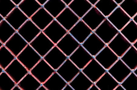 metal grate: Old rusty lattice, A metal grate with a rusty texture. Stock Photo