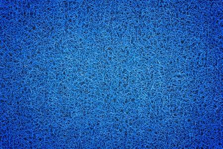 Blue carpet background, Blue plastic doormat texture and background. photo