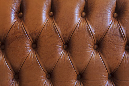 Brown leather texture - background, Brown leather texture of sofa closeup shot. photo