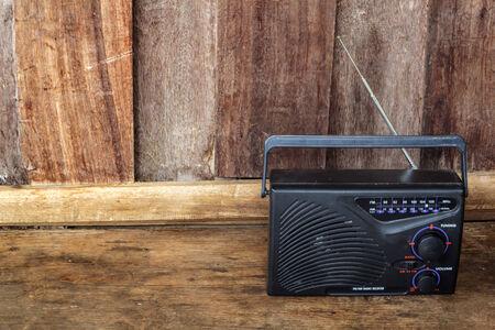 Vintage radio receiver device on wooden . photo