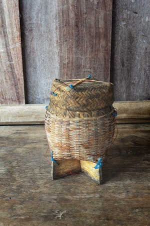 Thai bamboo sticky rice. Thai bamboo sticky rice container on wooden background. photo