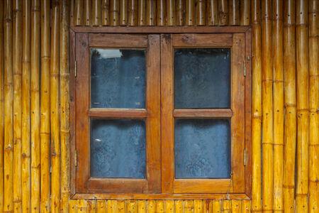 Wooden bamboo window on bamboo background. Wooden Window photo