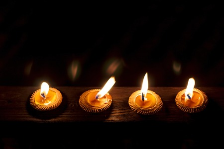 candle light: Closeup Group of burning candles Stock Photo