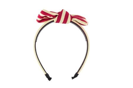 Rood-witte haarband die op witte achtergrond wordt geïsoleerd