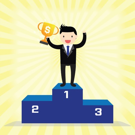 Businessman winner standing in first place on a podium holding up trophy