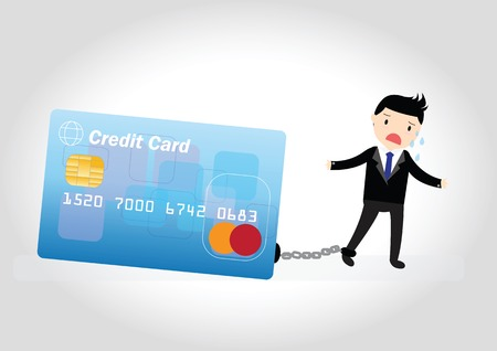 Businessman with debt bills and credit card