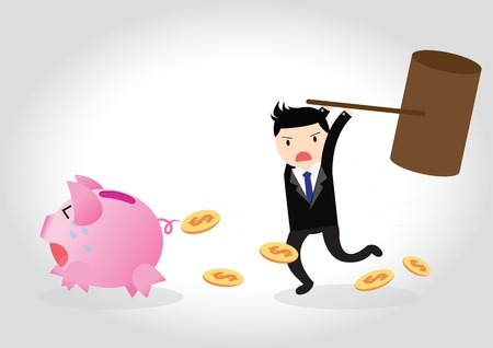 Businessman breaking piggy bank with coins  by big hammer