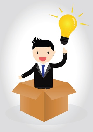 Businessman standing in box with idea lightbulb