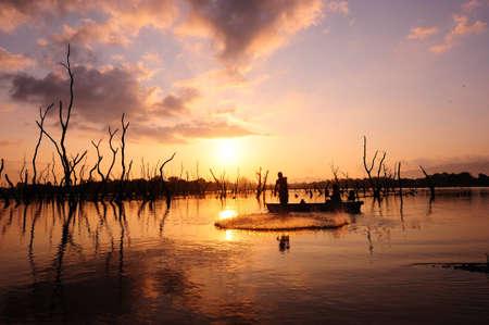 man fishing: Pescador de silueta