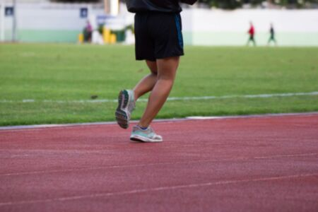 people running on a running track for fitness In the stadium