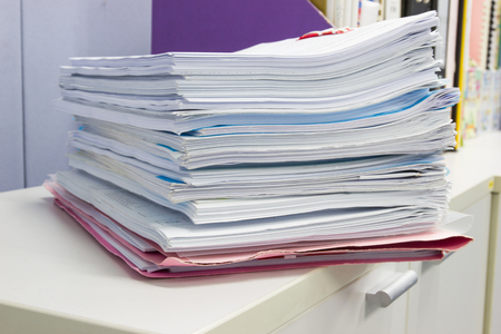 file folder and Stack of business report paper file on the table in a work office Stok Fotoğraf