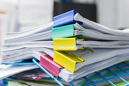File folder and Stack of business report paper file on the table in a work office