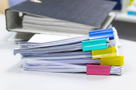 Stack of papers documents in archives files with paper clips on desk at offices, business concept. Stockfoto