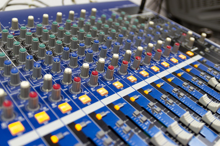 Mixing Console  of a big HiFi system  The audio equipment, control panel of digital studio mixer. 版權商用圖片