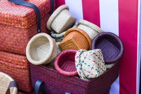Product Weaving A Wicker Basket By Handmade, Product work in the family industry. sale in a market of Thailand 写真素材