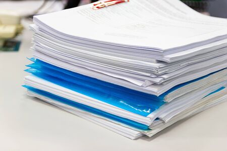 file folder and Stack of business report paper file on the desk in an office