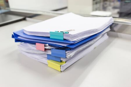 file folder and Stack of business report paper file with