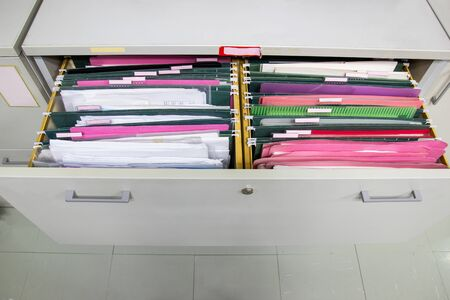 Files document of hanging file folders in a drawer in a whole pile of full papers, at work office Bangkok Thailand Business Concept
