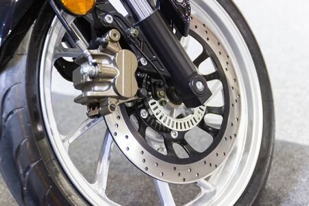 Close up - Detail Motorcycle brake disc and front wheel is part of the motorcycle.