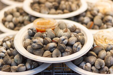 Steamed blanched cockles for cooking dinner with family at street food of Thailand Stok Fotoğraf