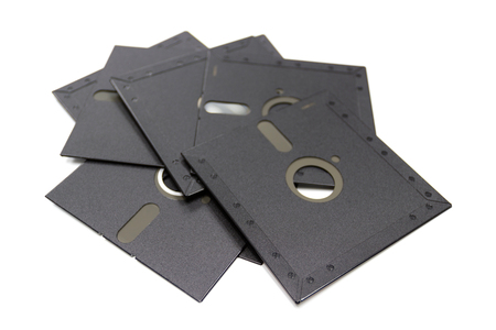 A floppy disk, also called a diskette or just disk, is a type of disk storage composed of a disk of thin and flexible magnetic storage medium, sealed in a rectangular - isolated - white background