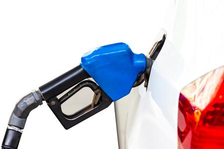 Gasoline dispenser nozzle fuel fill oil into car tank isolated white background copy space. Stock Photo