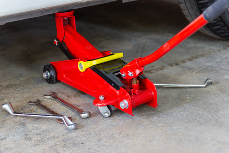 red tool jack lift car for repair check Maintenance of cars