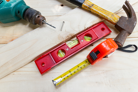 Construction equipment for carpentry Drill, hammer, wood, meter tape