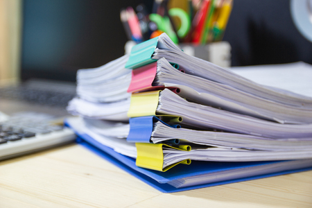 file folder and Stack of business report paper file on the table in a work office, concept document in work office Imagens
