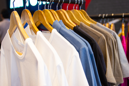Colorful t-shirt on hangers for sale in department stores.