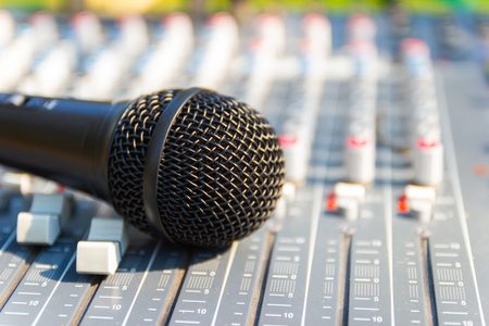 Close up Microphone on Mixing Console of a big HiFi system, The audio equipment and control panel of digital studio mixer