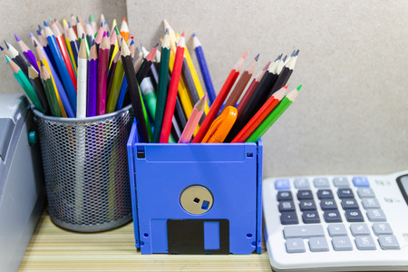 recycle floppy disk, Creative objects used for Store supplies such as pen pencils Scissors in a box on the table in work office, concept recycle floppy disk Stock Photo