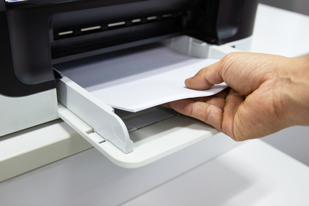 hand man lay down the paper from printer in the office, Business concept