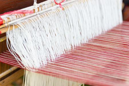 Weaving equipment Household weaving - Detail of weaving loom for homemade silk Used for silk weaving or textile production of Thailand Standard-Bild - 122566089