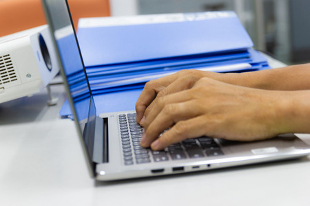 business man typing on laptop keyboard in work office concept business life work office Imagens