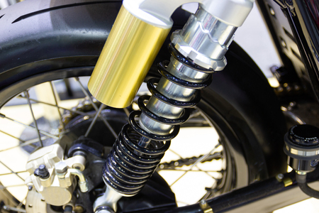 Black Shock Absorbers part of Motorcycle is a part for preventing shock