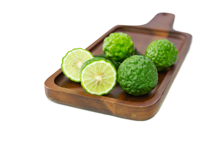fresh fruits bergamot with cut in half on wood table.