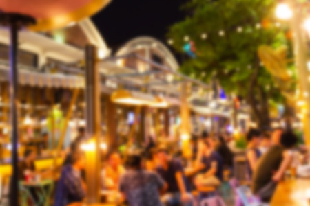 abstract blur image Lots of people enjoy the fun of night festival in a restaurant and The atmosphere is happy and relaxing. Imagens