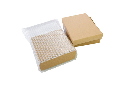 Bubbles covering the box by bubble wrap for protection product cracked  or insurance During transit -isolated white background 免版税图像