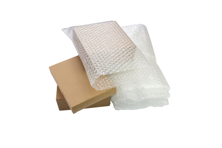 Bubbles covering the box by bubble wrap for protection product cracked  or insurance During transit -isolated white background Reklamní fotografie