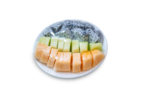 fruits which are wrapped with plastic film preservation on a table on white background