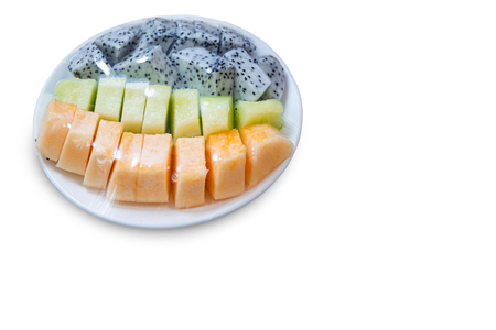 fruits which are wrapped with plastic film preservation on a table on white background copy space