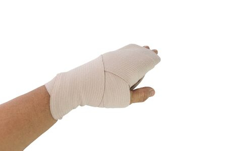 Man applying compression bandage for wrist de wearing bandage due to inflamed wrist tendons isolate white background.