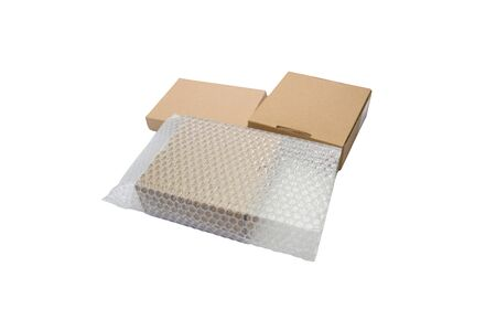 Bubbles covering the box by bubble wrap for protection product cracked  or insurance During transit -isolated white background copy space
