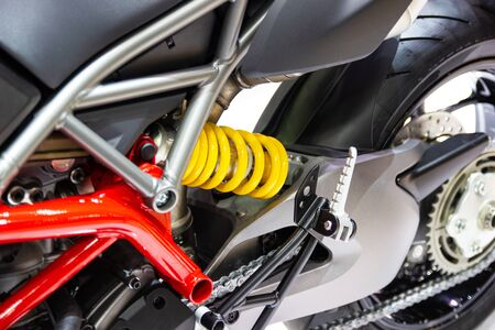 yellow Shock Absorbers of Motorcycle for absorbing jolts net technology concept new technology design
