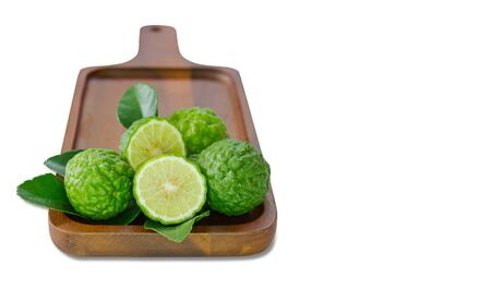 fresh fruits bergamot with cut in half on wood isolated white background copy space.